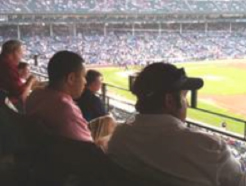 Customers take in a Cubs game at the Rand McNally event.